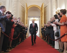 New Russian President Vladimir Putin walks as he attends the inauguration ceremony at the Kremlin in Moscow