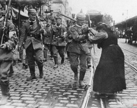 Prussian guard infantry in New Field gray uniforms leave Berlin, Germany to entrain for the front, August 1914 during World War I. Girls and women along the line of march and out flowers to them. (AP Photo)