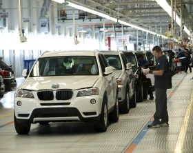 GREER, SC - OCTOBER 19:  (note to eds: WORKER IS UNIDENTIFIED IN THIS IMAGE) A production associate inspects a  BMW X3 Sport Activity Vehicle as it travels down the assembly line at the new Assembly North plant at the BMW plant in Greer, SC, Tuesday, October 19, 2010. (Photo by Nanine Hartzenbusch/For the Washington Post)