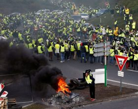 Protesters wearing yellow vests, a symbol of a French drivers' protest against higher fuel prices, attend a demonstration at the entrance of a shopping center in Nantes, France, November 17, 2018. REUTERS/Stephane Mahe